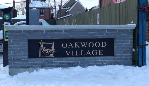 The new Oakwood Village sign at the Green P lot, 341 Oakwood Ave.