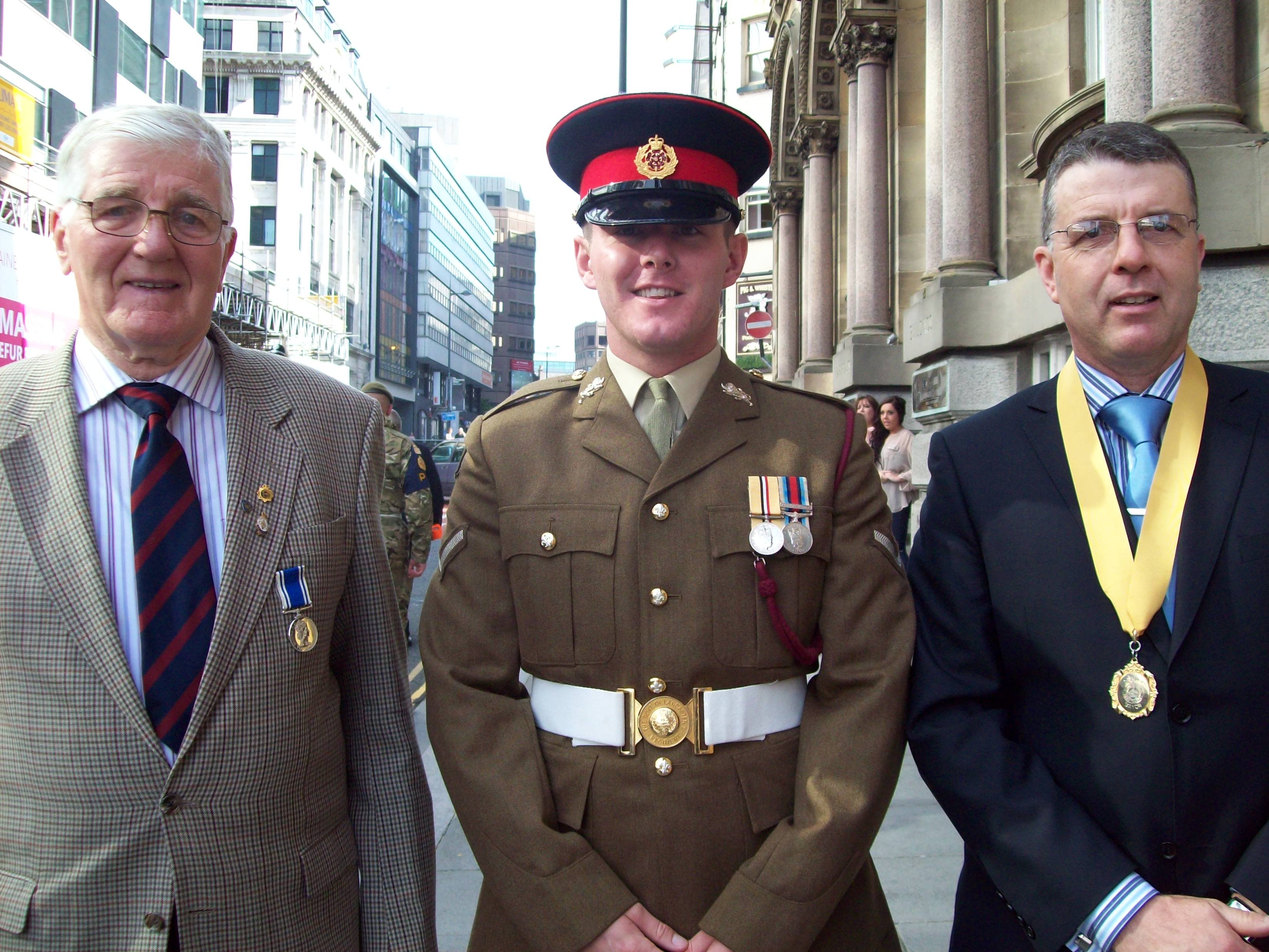 Deputy Mayor of Maghull Cllr Steve Kermode with dad James Kermode and Lance Corporal Wayne Floyd of the 2nd Battalion, The Duke of Lancaster's Regiment.