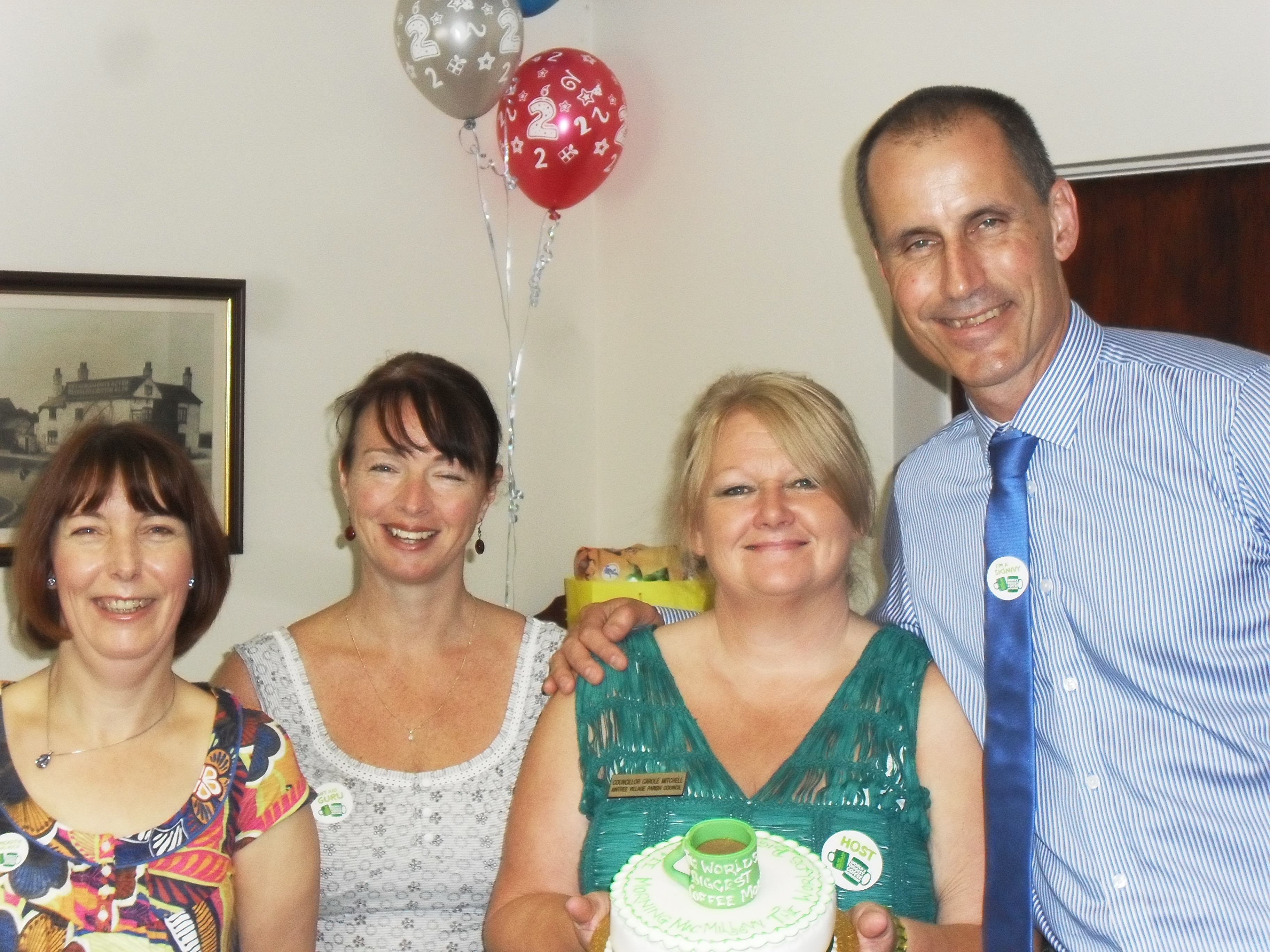 Bill Esterson MP with Aintree Village Parish Council chairman Carole Mitchell, Jan Pearse and Sheila Smith at the Macmillan Cancer Coffee Morning at the Harrow Drive council chamber.