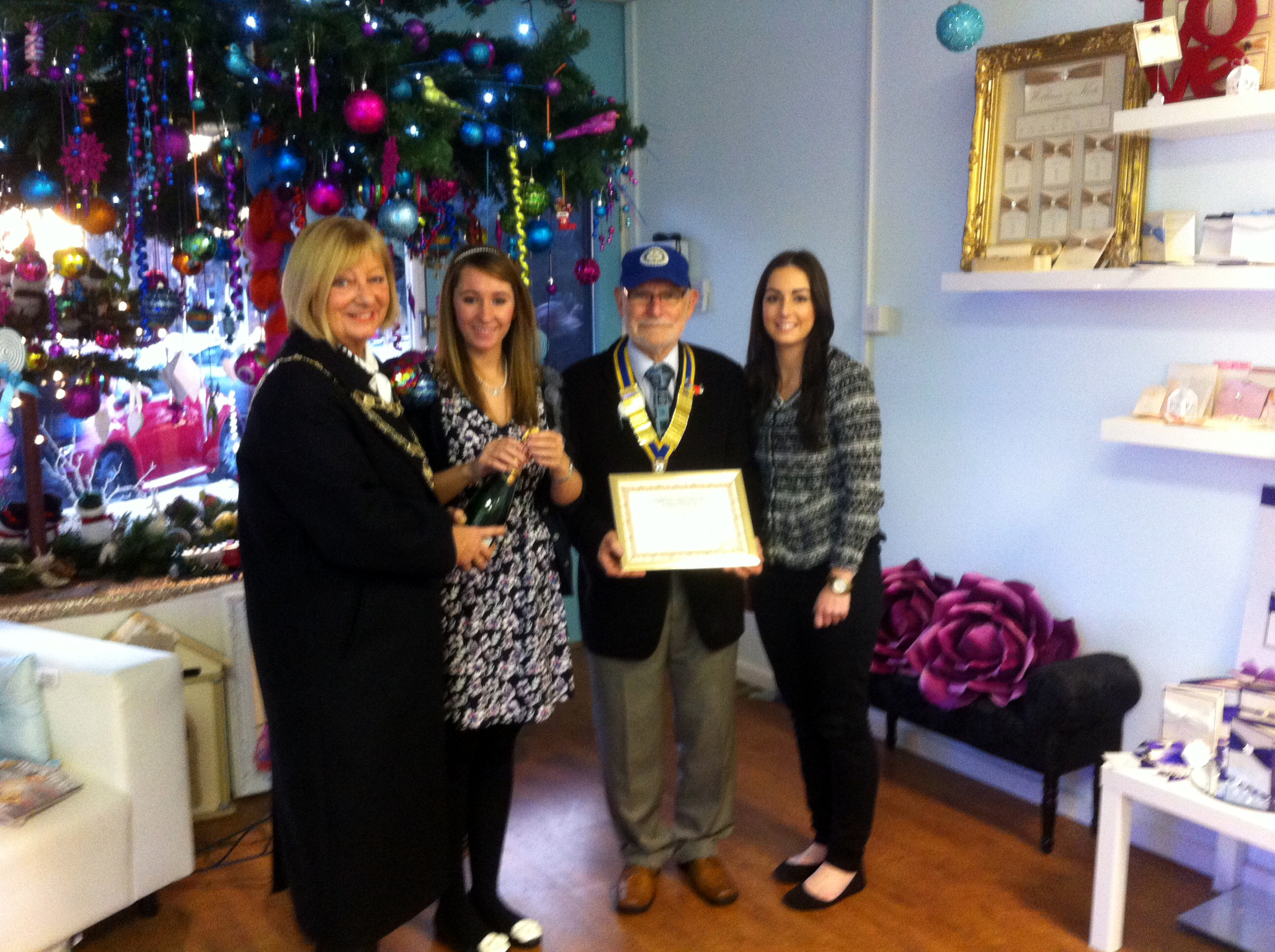 Mayor of Maghull Cllr Joan Deegan and Maghull & Aughton Rotary Club president Simon Rennie with Best Dressed Window winners, The Paper Doll wedding stationers' Sarah-Jayne Cluney and colleague Heather Williams.