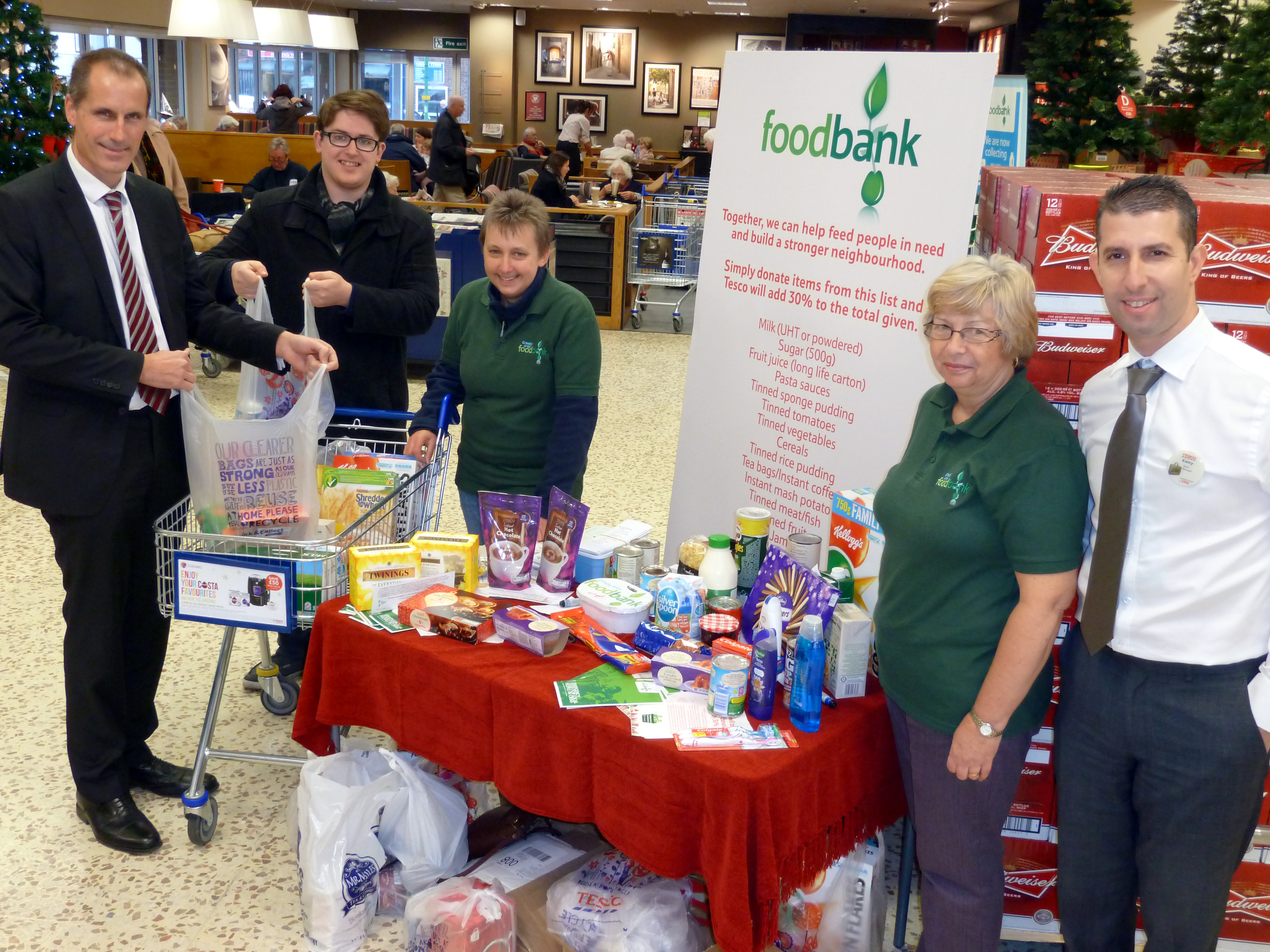 Sefton Central Labour MP Bill Esterson and Formby Labour Action Team's Tom Donnelly with Formby Tesco store manager Kemy Lassami and Crosby AreaFoodbank's Jean Gamble and Mavis Evans.