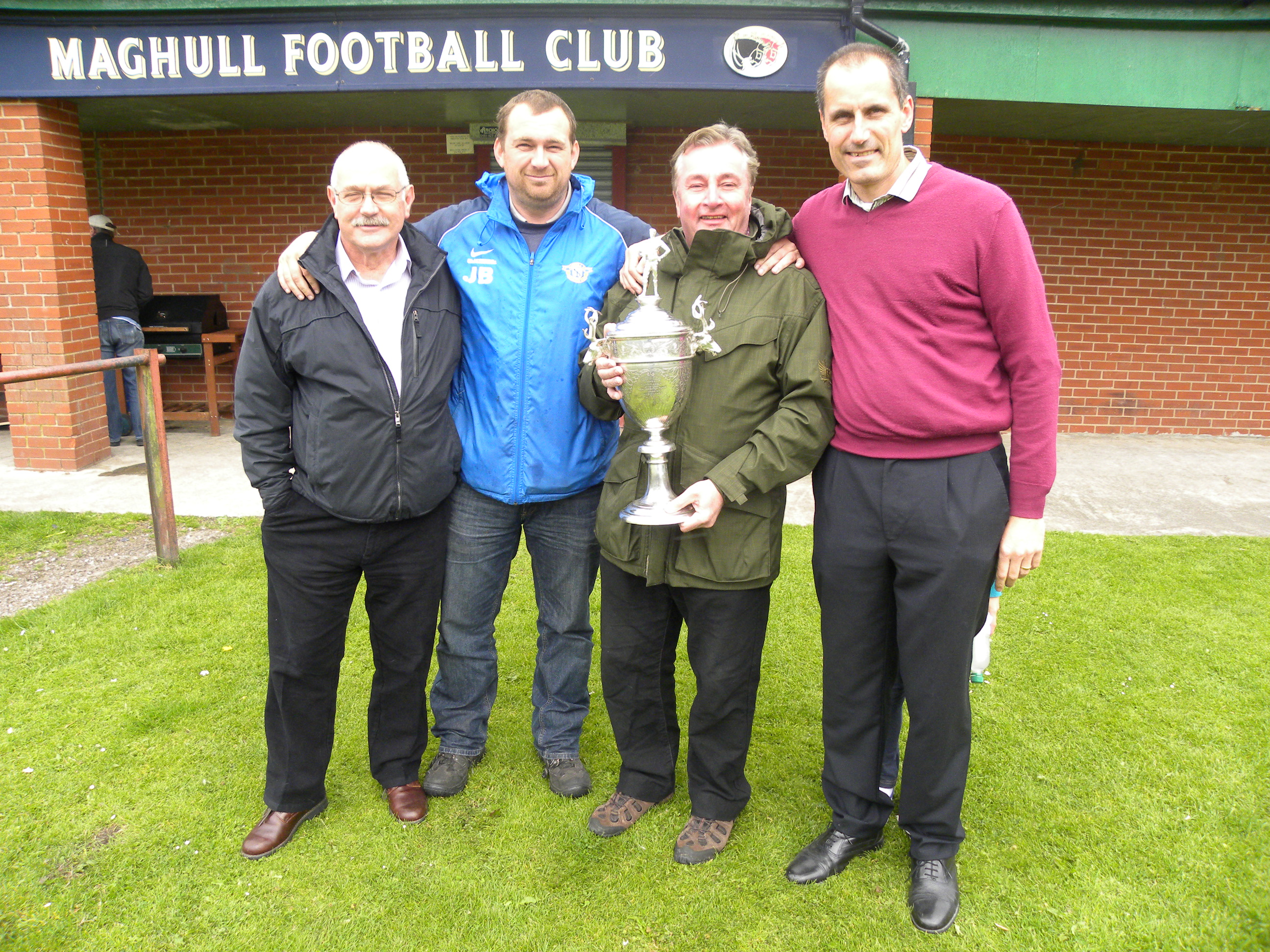 New maghull Town Councillor Maurice Byrne and Sudell Ward's Cllr Patrick McKinley with Bill Esterson MP and Maghull FC 1st team manager John Brownrigg.