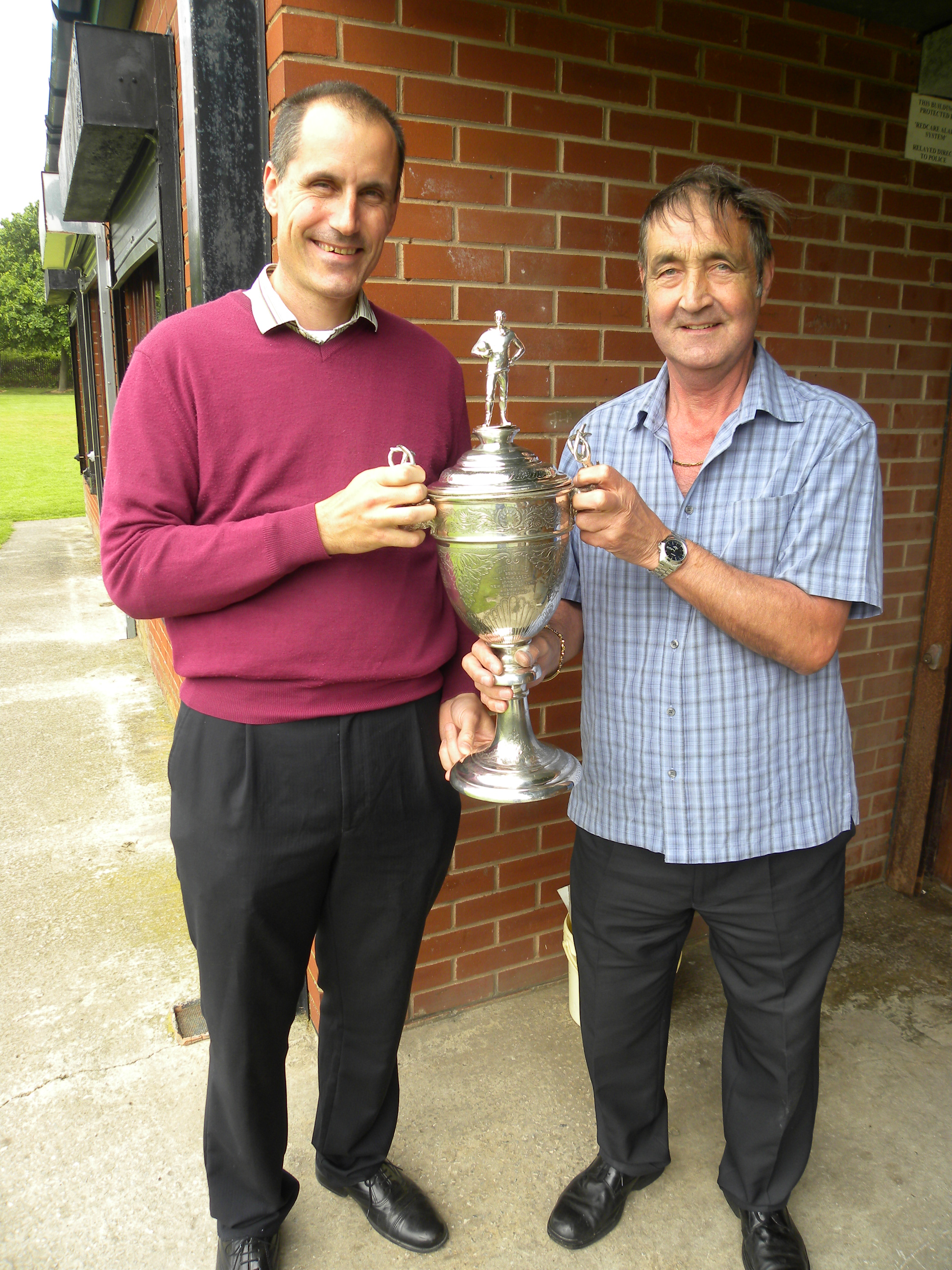 Maghull Labour MP Bill Esterson holds the Pyke Cup with Maghull FC chairman Les Jacques.