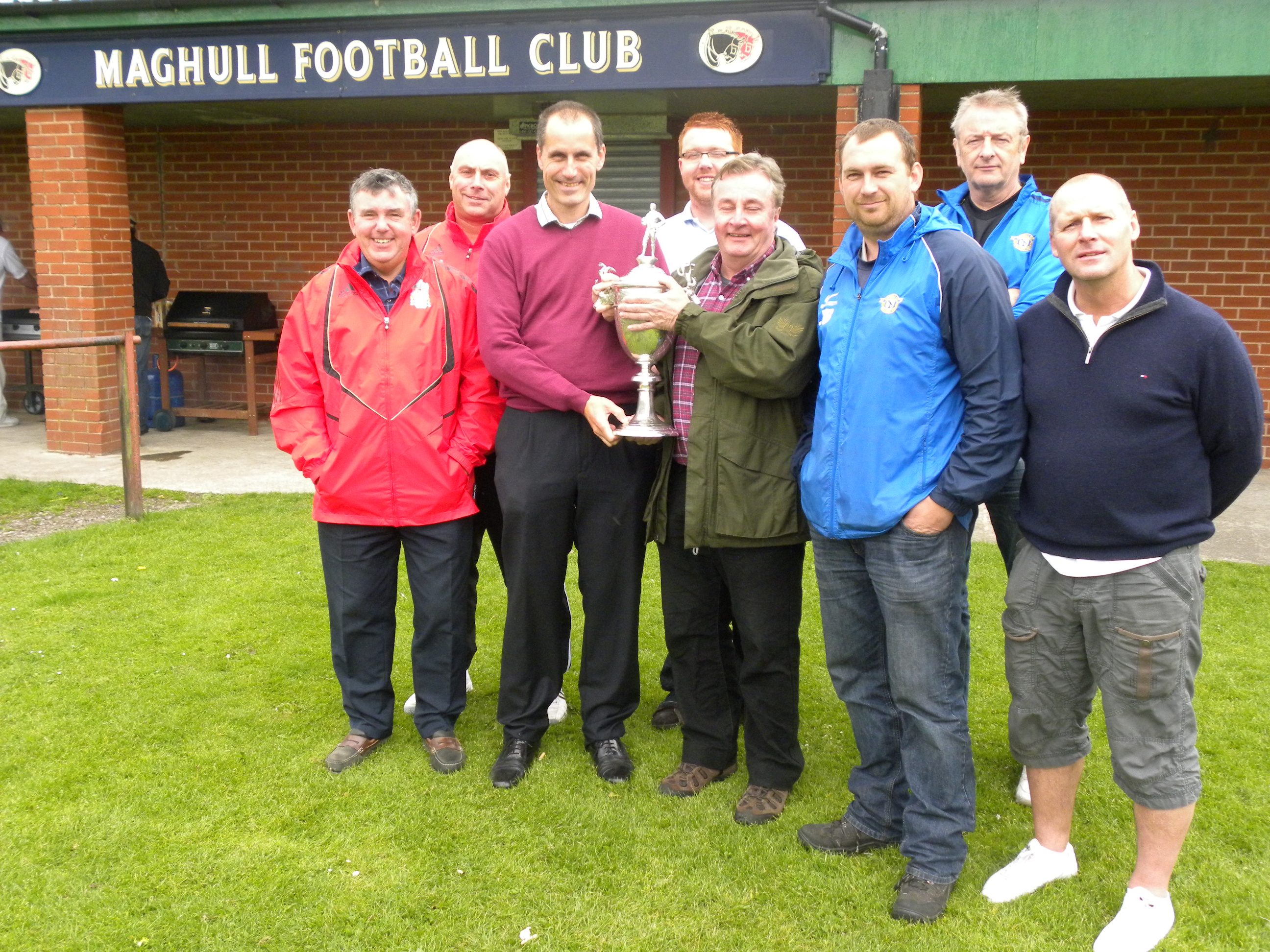 Maghull Labour MP Bill Esterson and Seudell Ward's Cllr Patrick McKinley with Maghull FC's club secretary Bill Buck, financial offier Dave Jones, community officer Adam  Rooney, first team manager John Brownrigg, head of youth football Allan Watkinson and director of football John Mcinnes.