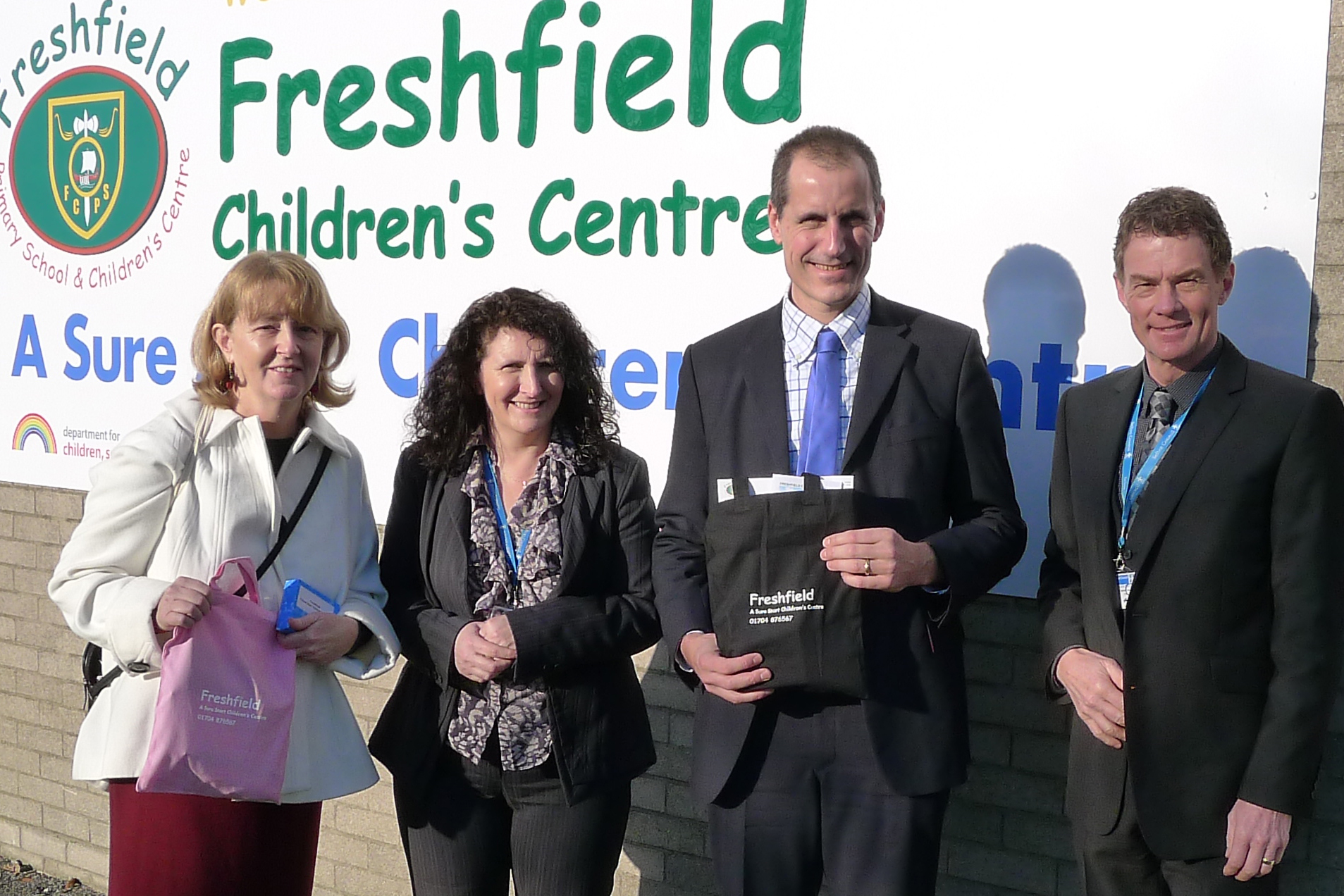 Catie Page and Bill Esterson with Freshfields Children's Centre staff