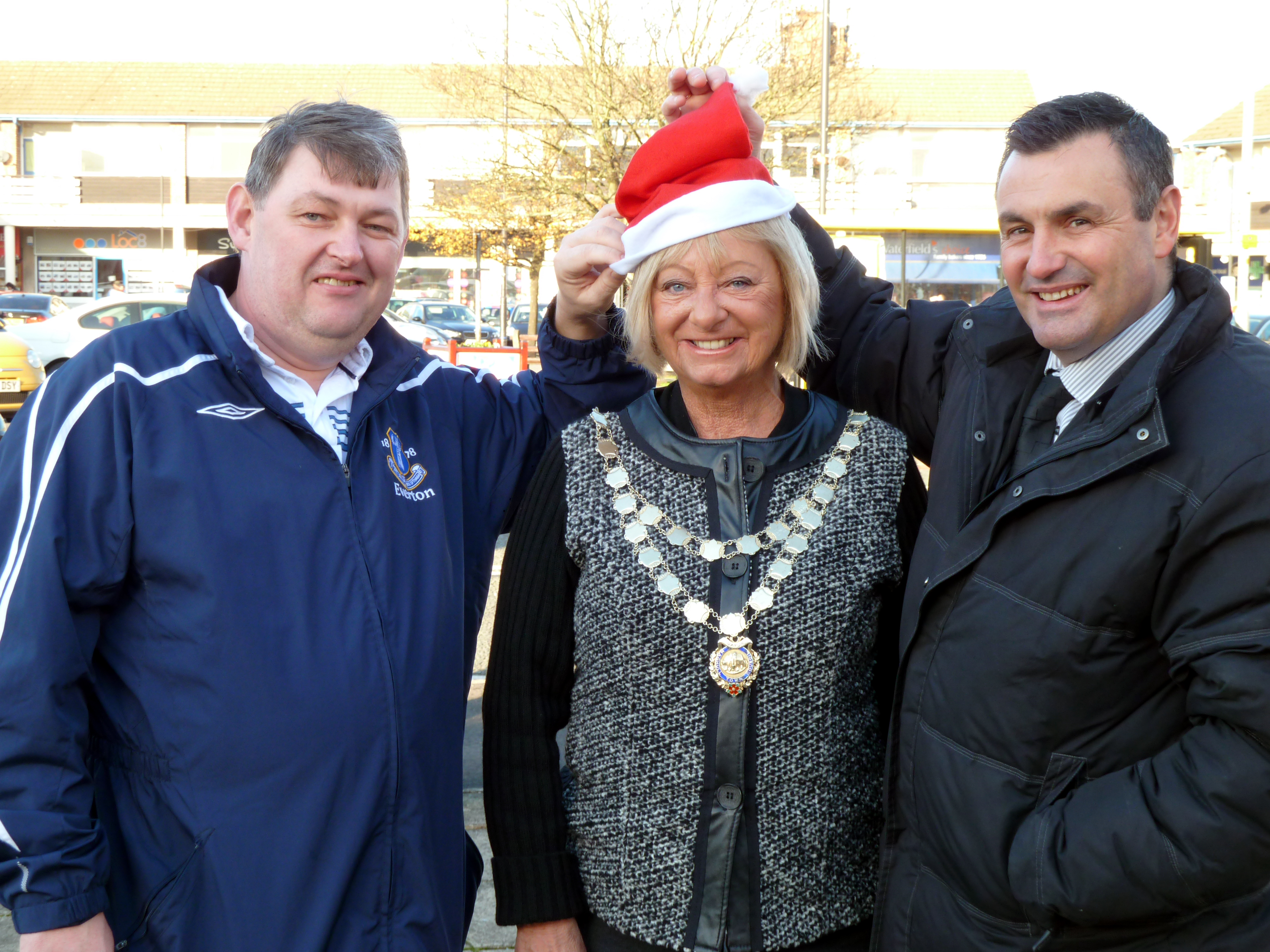 Mayor of Maghull, Labour's Cllr Joan Deegan, fellow Labour Councillor John Jarvis with Maghull Town Team's Steve Maxwell, busy preparing for Maghull's big Christmas lights switch on.
