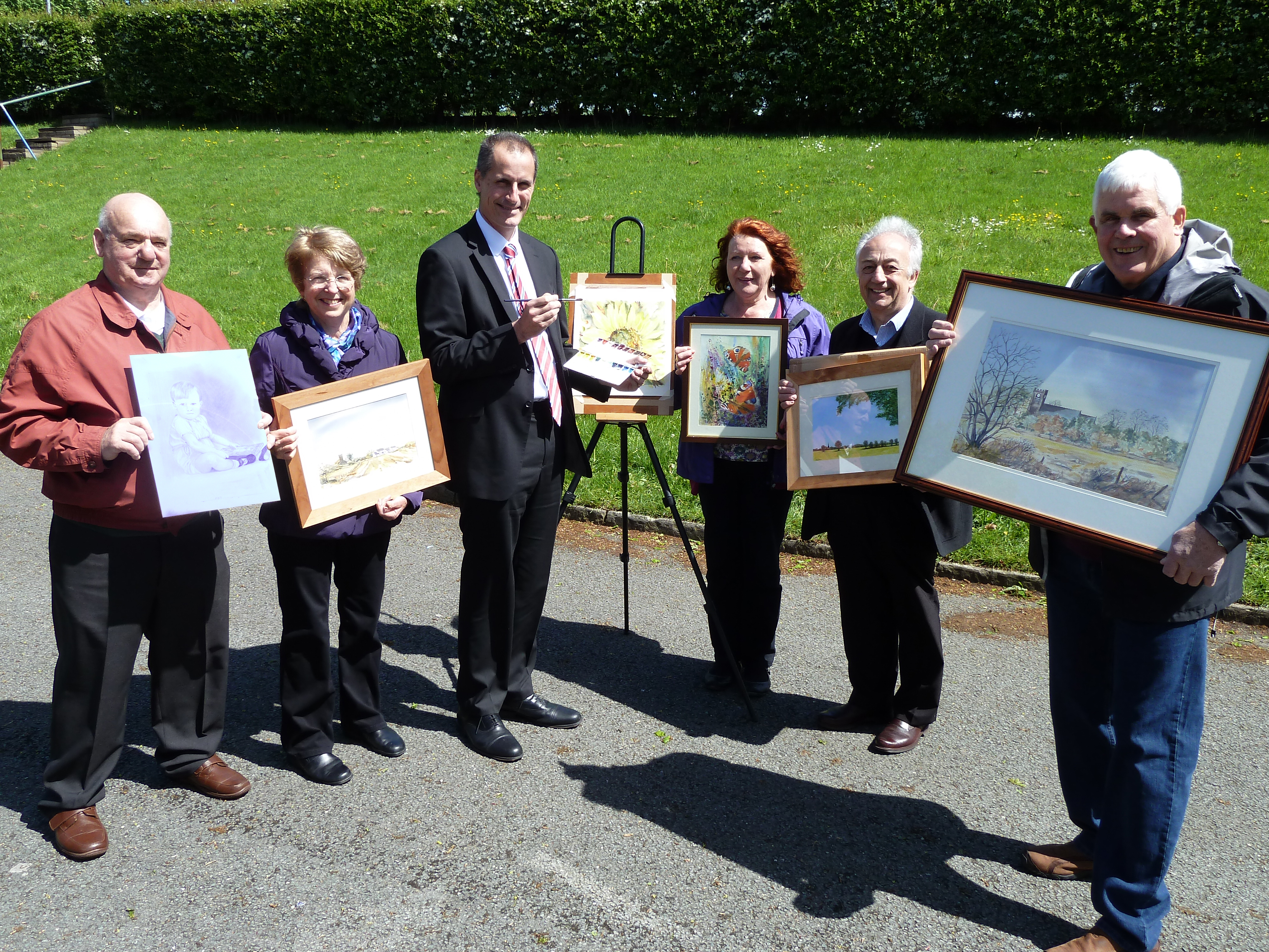 Sefton Central Labour MP Bill Esterson tries out his artistic skills with Maghull Art Group's Ted Reddy, Di Pearson, Lelia Howarth, Tony Rimmer and Bob Joy ahead of the group's exhibition.