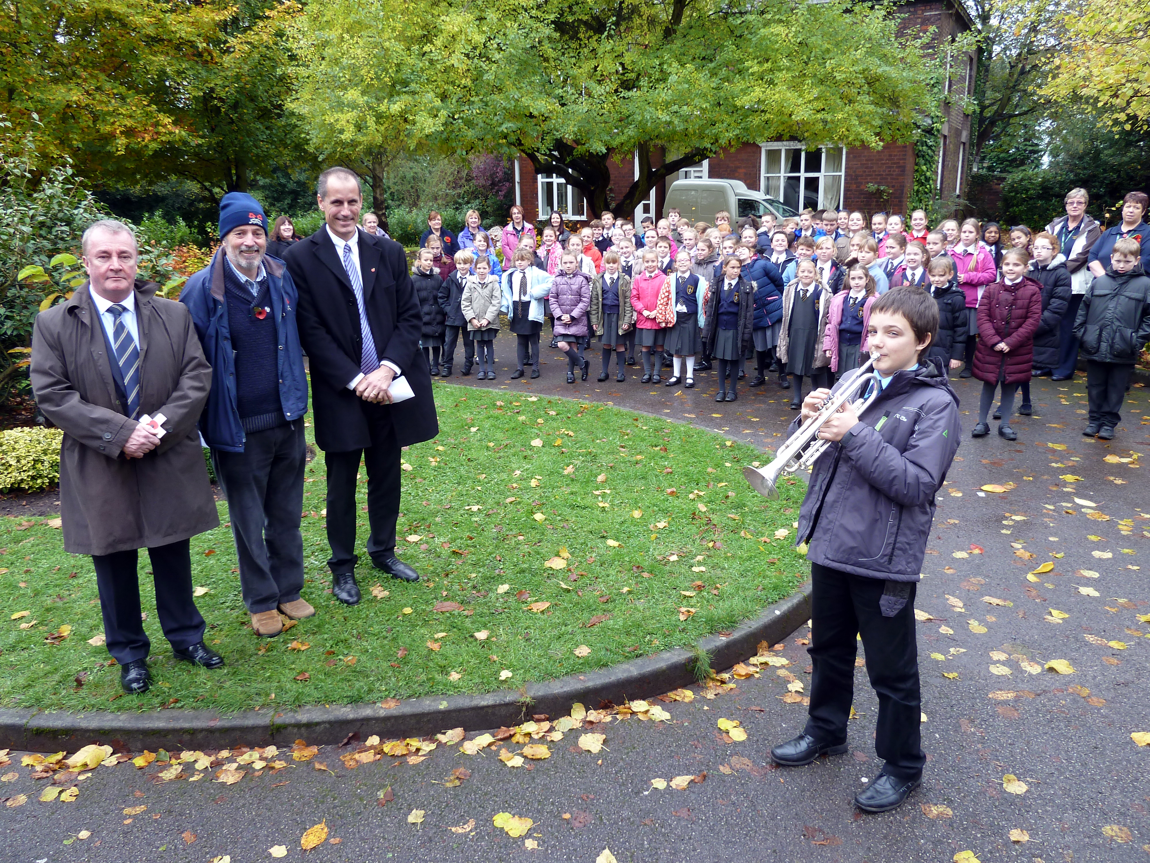 Sefton Central Labour MP Bill Esterson with Maghull Labour Councillor Patrick McKinley, Cllr Bruce Hubbard, St Andrew's trumpet player Joe Fay and pupils at the Maghull Remembrance Day Service.
