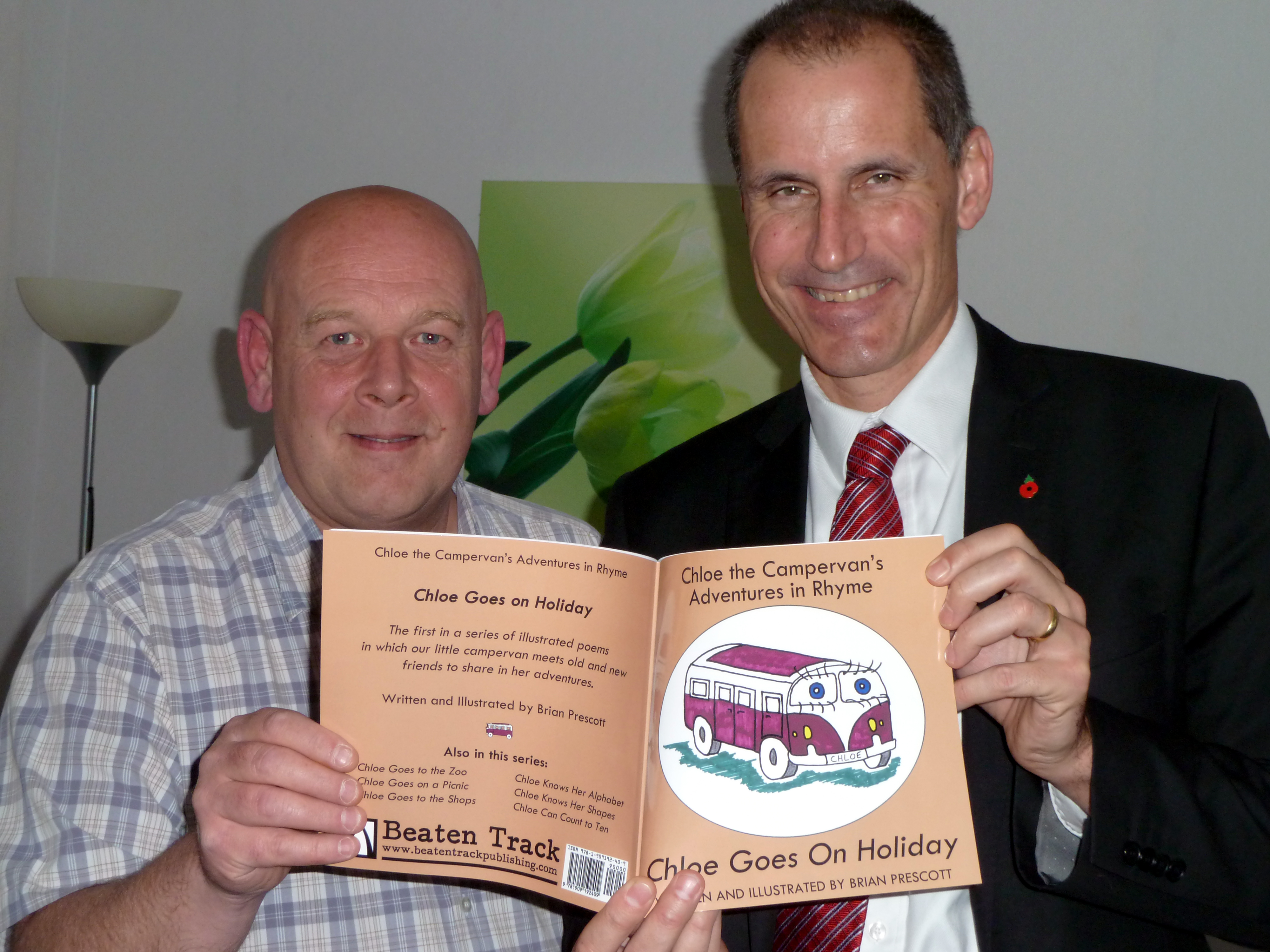 Sefton Central Labour MP Bill Esterson with new children's author Brian Prescott from Aintree Village and copies of his Chloe the Campervan books.