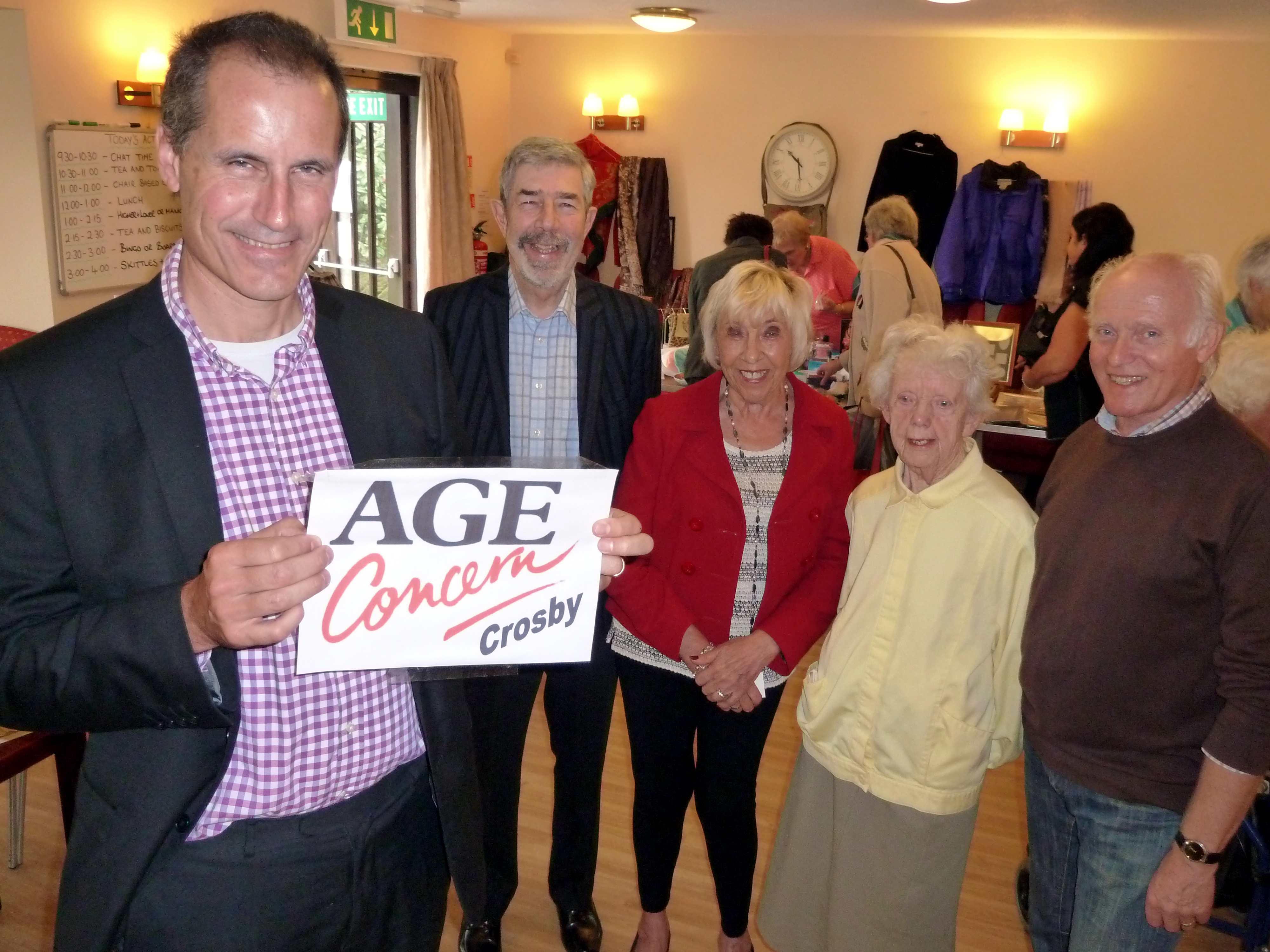 Sefton Central Labour MP Bill Esterson joins Age Concern Crosby vice chairman Anthony Hill, office manager Shirley Higgs, secretary Jean Kerrigan and chairman Chris Dale at the fundraising coffee morning at the Haigh Road Day Centre.