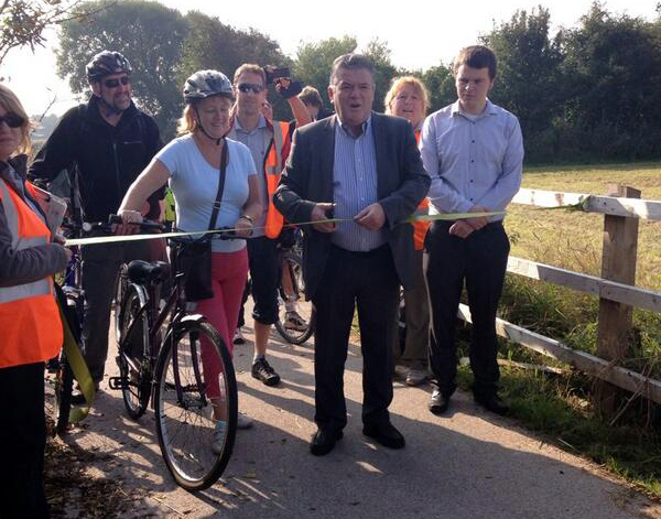 Formby Labour Councillors Peter Maguire and Catie Page with Labour Cabinet Member for Technical Services Cllr John Fairclough at the official opening of the refurbished Formby-to-Hightown cycle path.