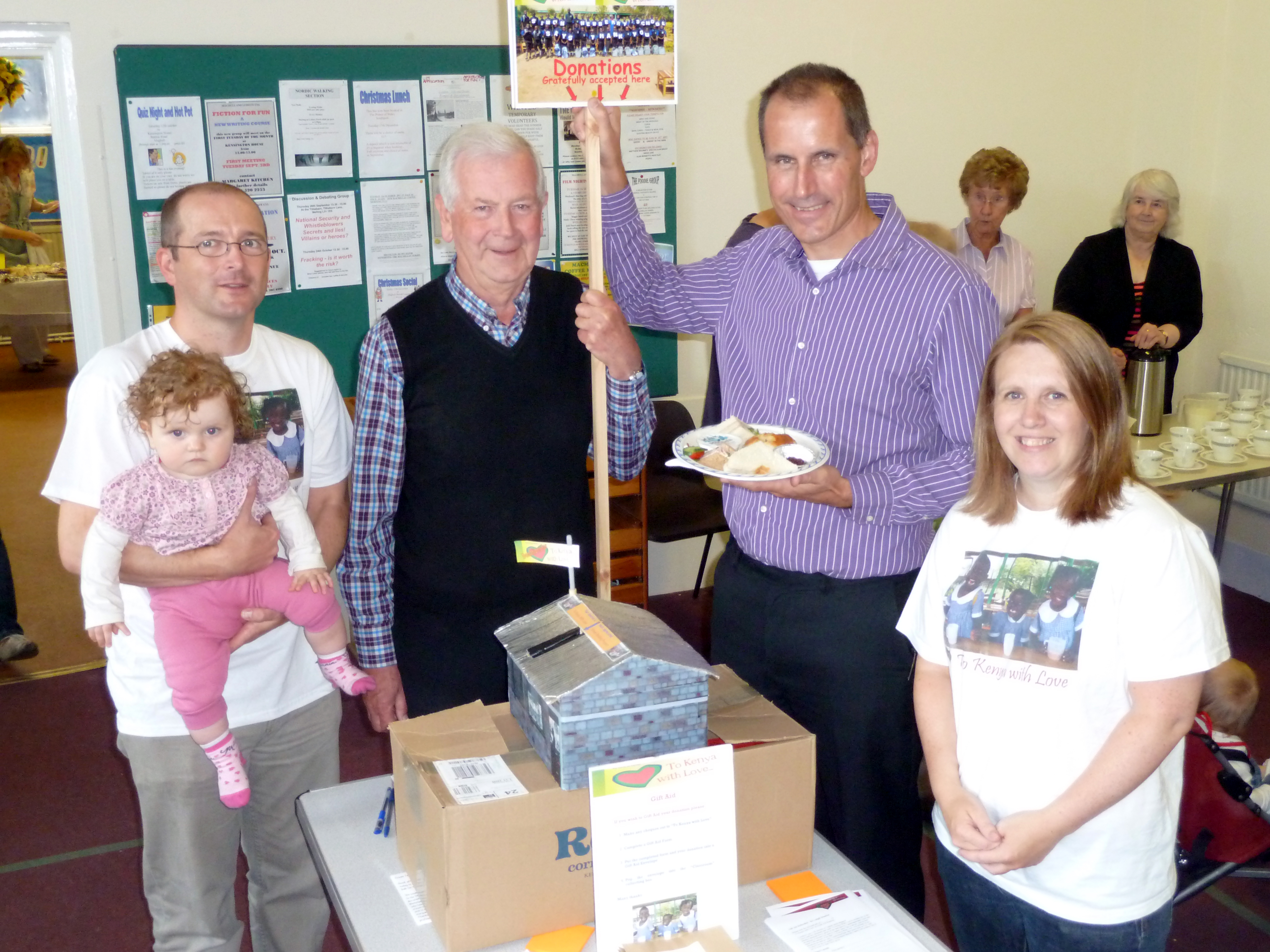 Sefton Central Labour MP Bill Esterson with Maghull Baptist Church To Kenya With Love Clotted Cream Tea fundraiser organisers Geoff Halligan, Phil and Di Ball and daughter Maiya.
