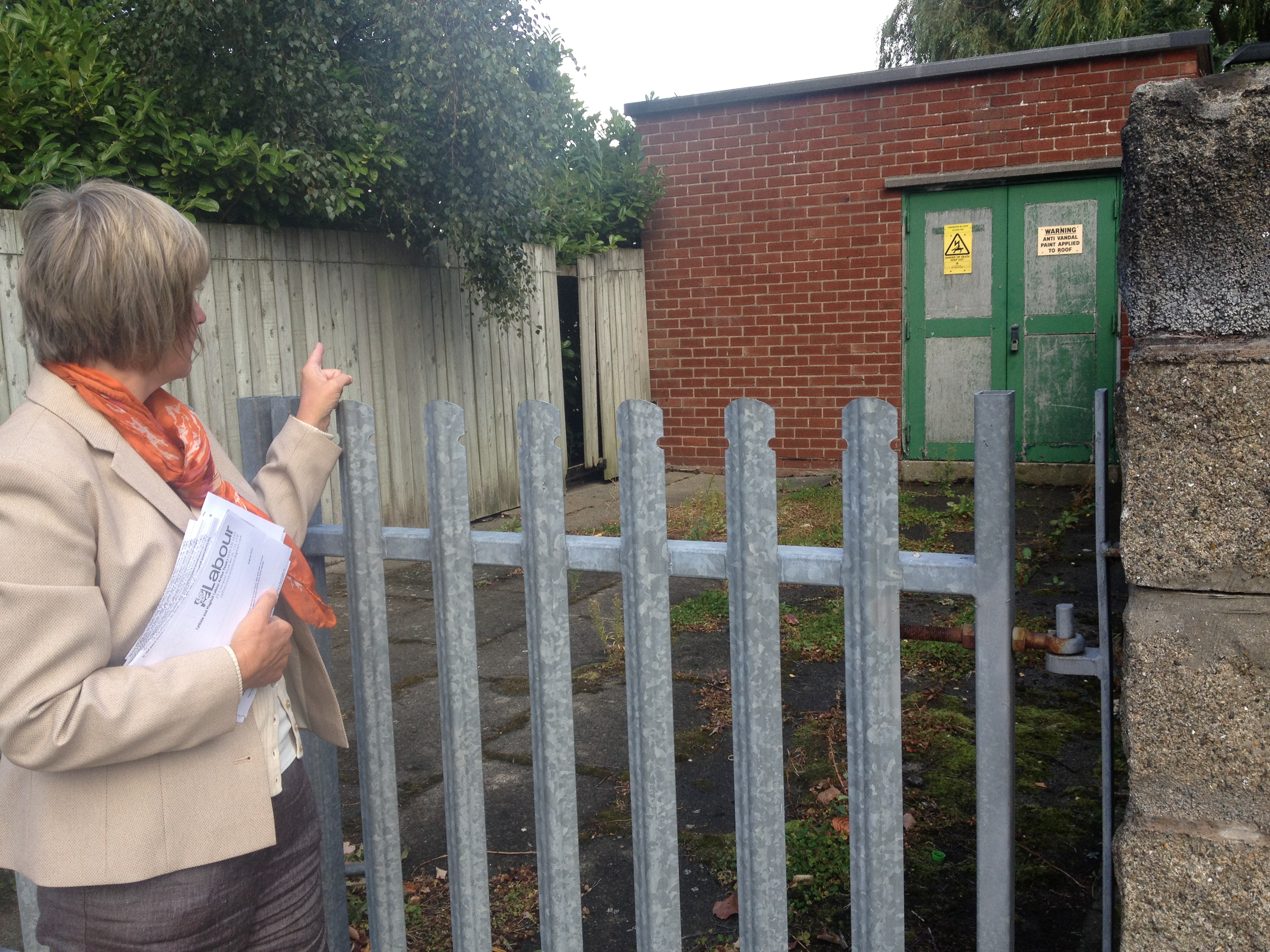 Maghull & Lydiate Labour Action Team's June Burns at the electricity substation where the security fence has been vandalised on Coronation Road in Lydiate.