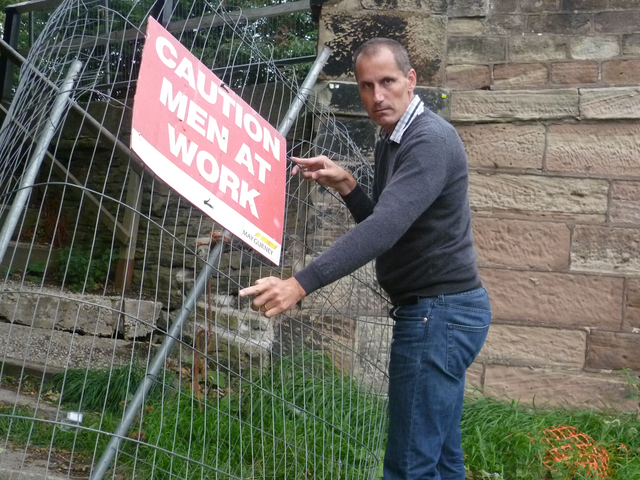 Bill Esterson MP with the sign which suggests work is underway.