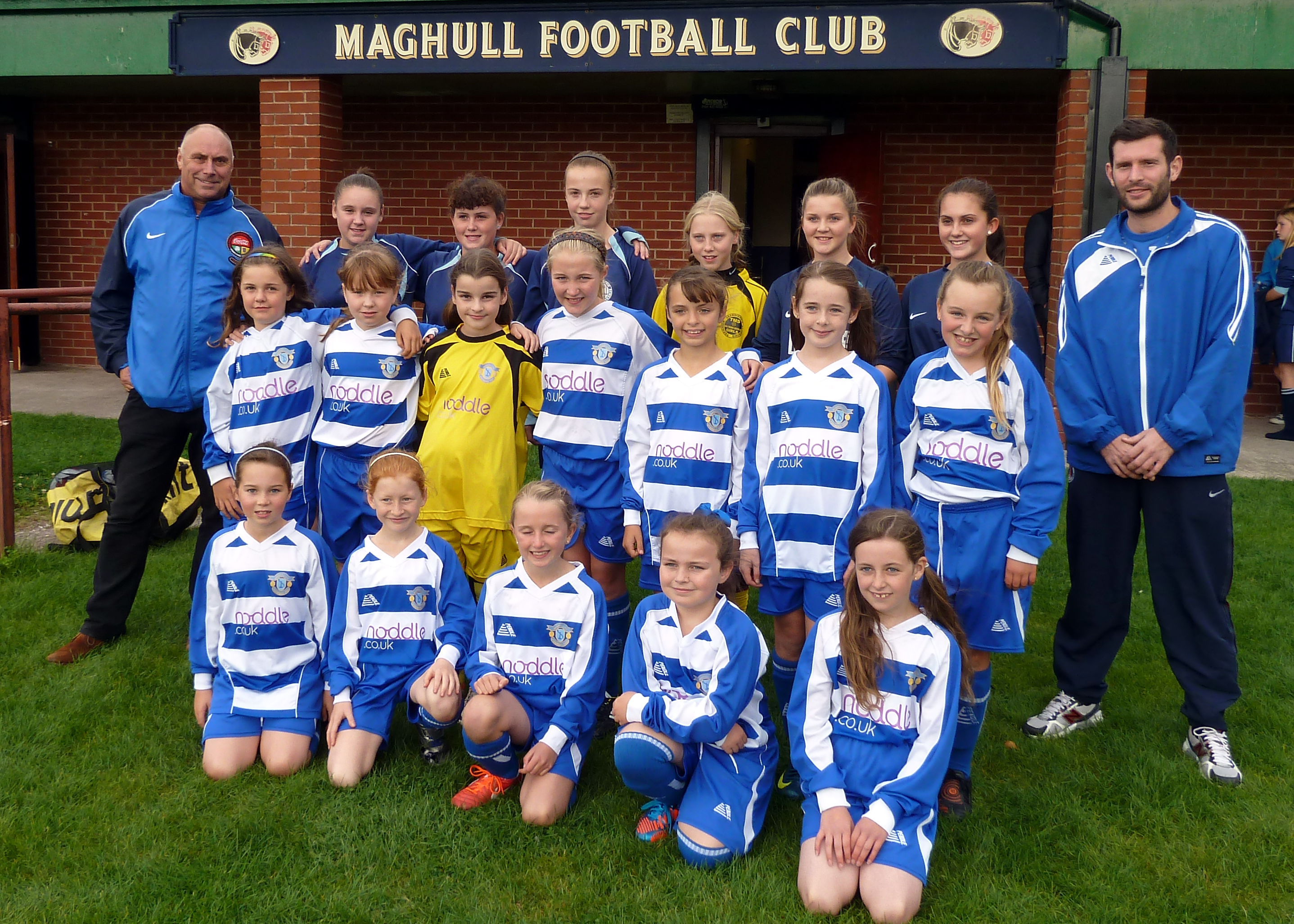 Maghull Labour Councillor Dave Jones and girls' team manager Steve Rafferty with some of the new players.