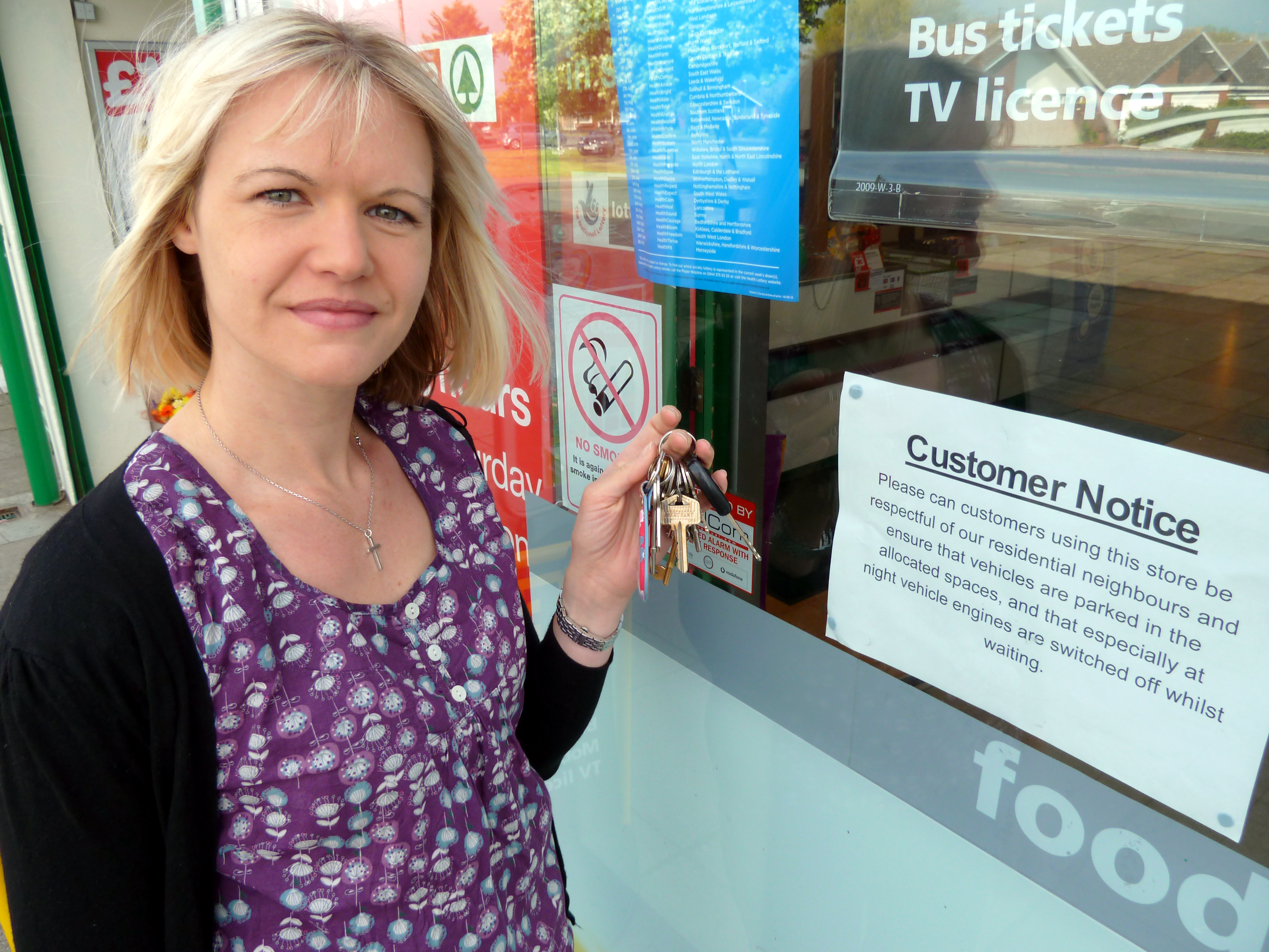 Formby Labour Councillor Nina Killen outside Harington Road Spar where the new notice calls on customers to make sure that they turn off their car engines when visiting the shop.