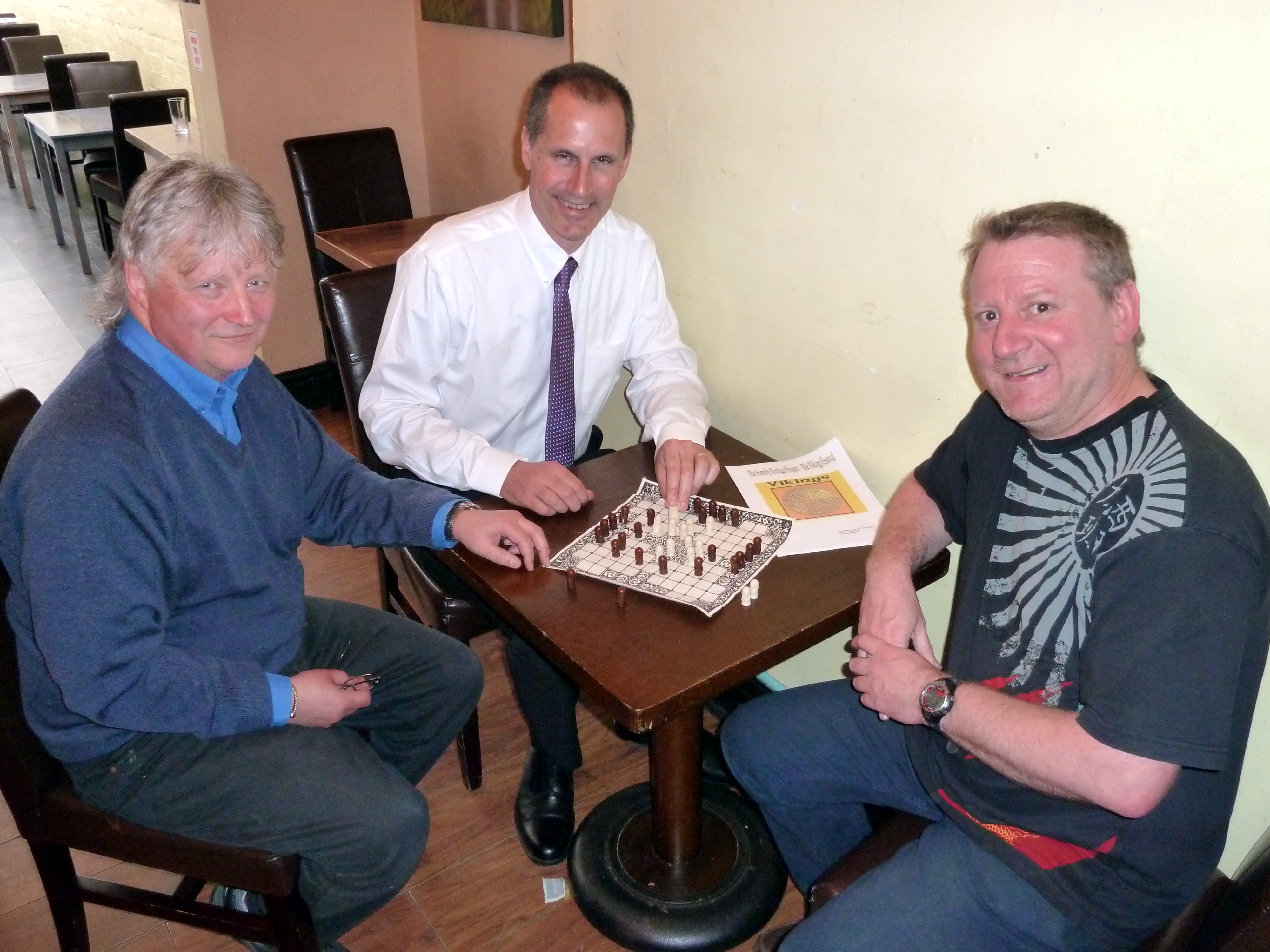 Sefton Central Labour MP Bill Esterson tries his hand at the Formby Viking Game with club founders Leo Kolassa and Tony Higginson.