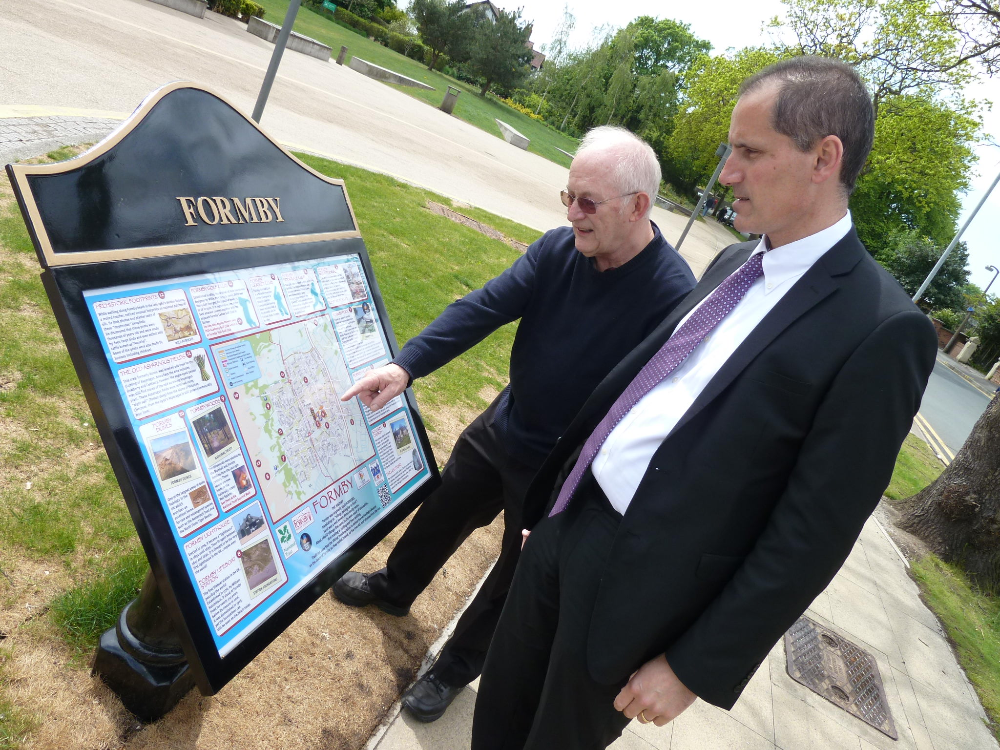 Sefton Central Labour MP Bill Esterson is shown the new information boards in Formby Village by Formby Parish Councillor Geoff Gaskin.