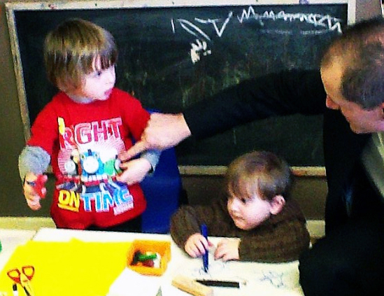 Bill Esterson and Caroline Esterson with children at It's the Little Things nursery in Maghull