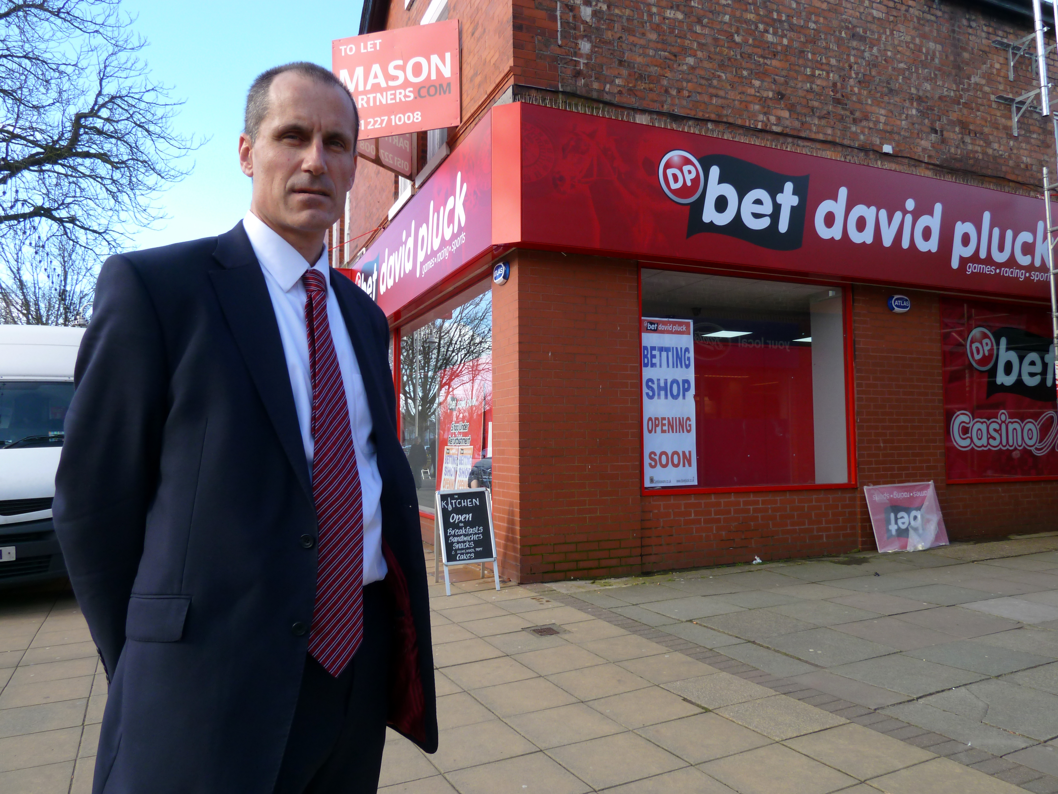 Sefton Central Labour MP Bill Esterson outside the new betting shop in Formby Village.