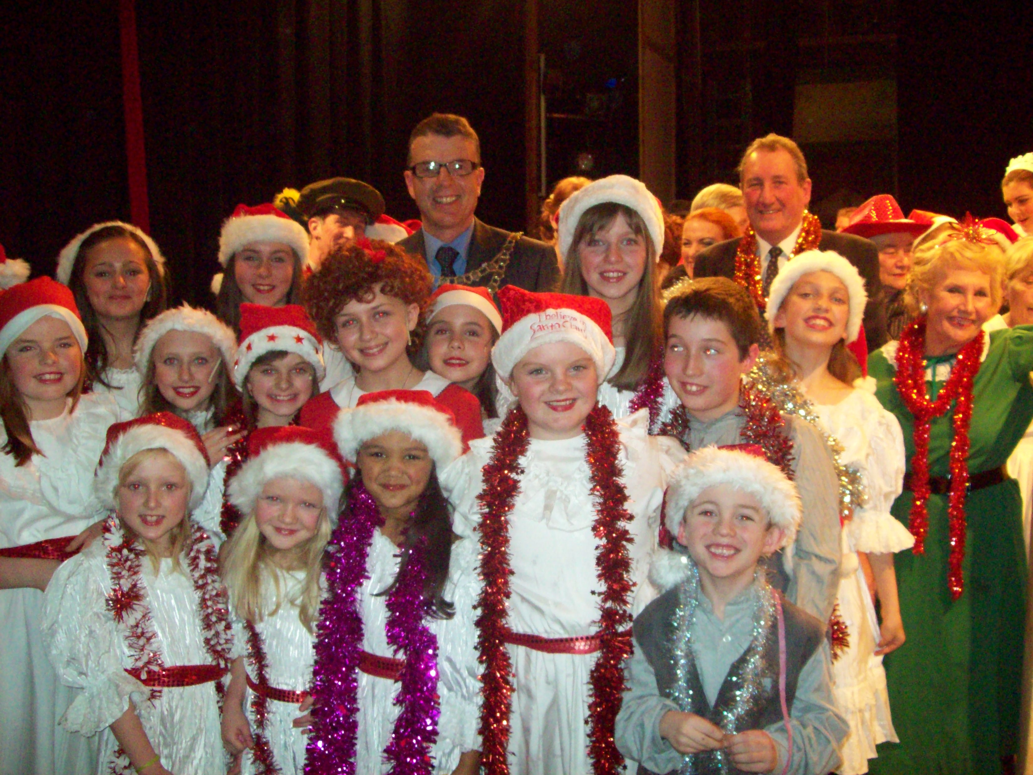 Mayor of Maghull Cllr Steve Kermode with some of the young cast members of Maghull Musical Theatre Company's performance of Annie.