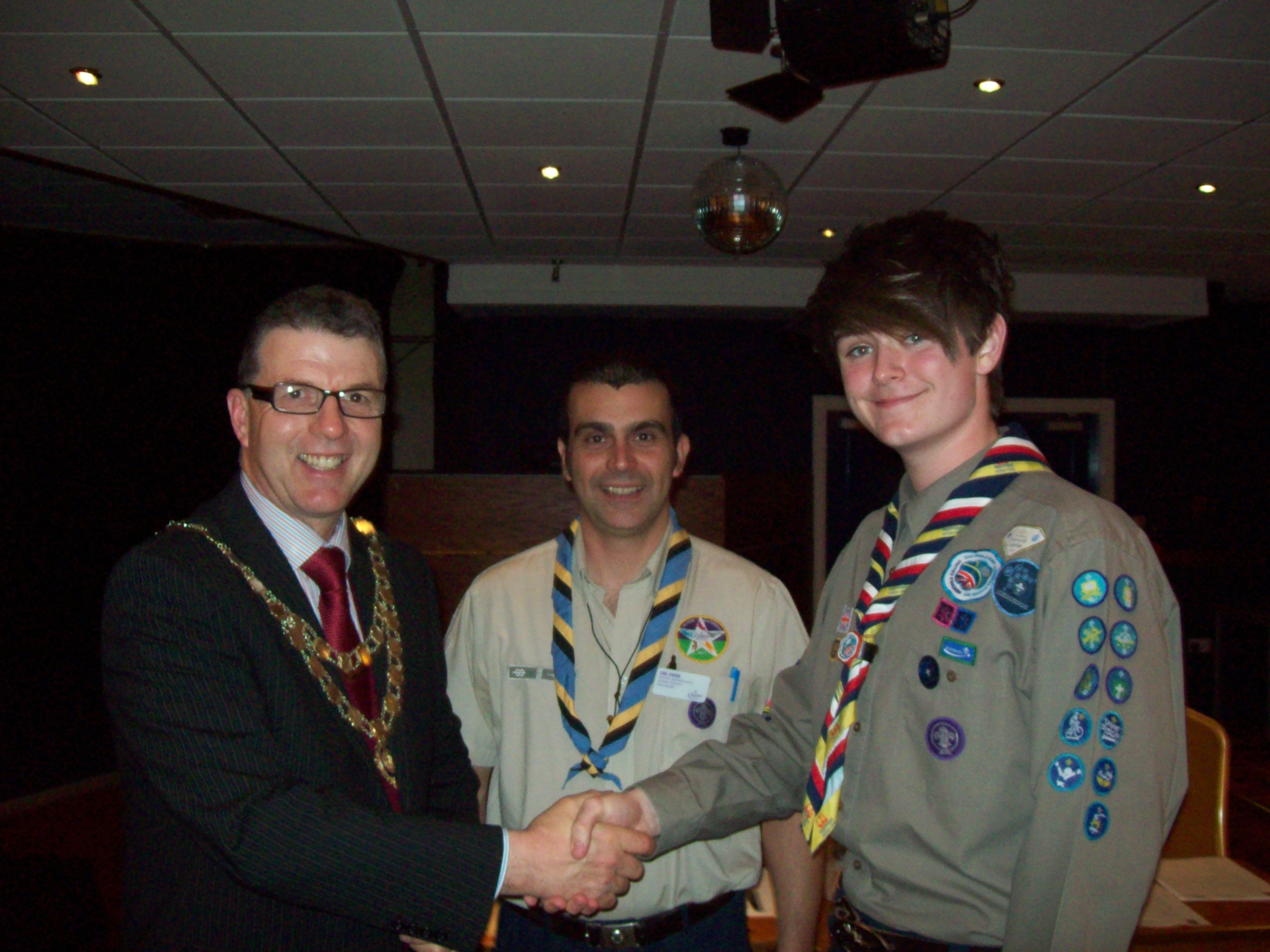 Mayor of Maghull, Labour's Councillor Steve Kermode with Alex Clare of the 1st Sefton East Scouts and District Commissioner Lee Cook.