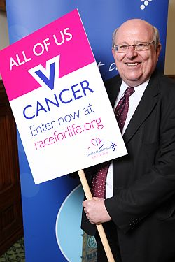 Mike with race for life banner