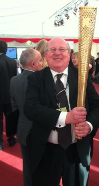 mike with olympic torch