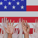 Hands reaching in air with United States flag in background