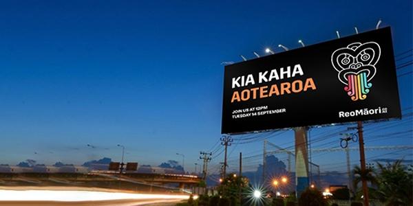 Billboard with the words Kia Kaha Aotearoa and the</p> <p>Hei Tiki logo