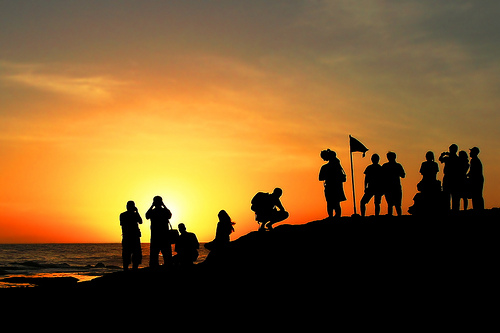 people gathered at sunset