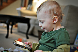 Baby checks email on phone