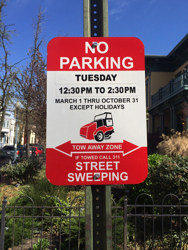 A view of DC's street sweeping signs.