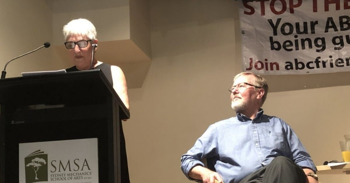 Sandra Levy reports back to the 100 strong AGM crowd as Quentin Dempster listens