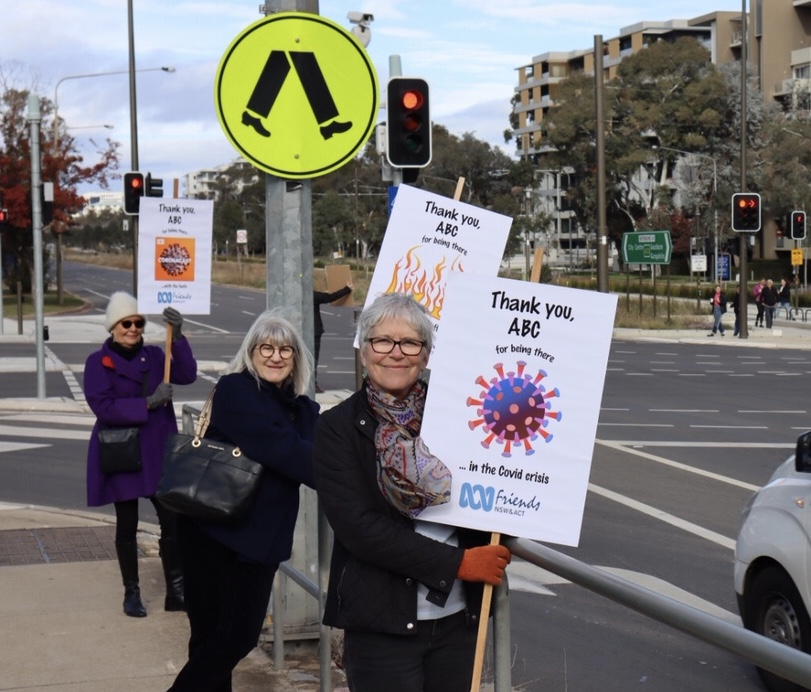 ACT Branch members Jane, Sue and Gia brandish appreciative posters outside the ABC Studio in Canberra