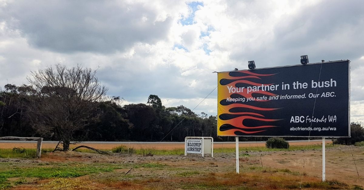 The billboard in situ. The billboards reads: Your partner in the bush. Keeping you safe and informed. Our ABC. ABC Friends WA (logo)