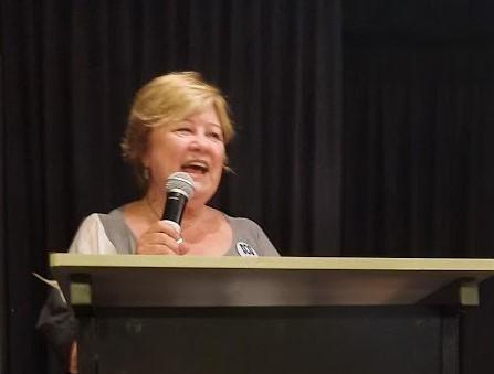 ABC Friends NSW&ACT President Cassandra Parkinson speaking at the podium