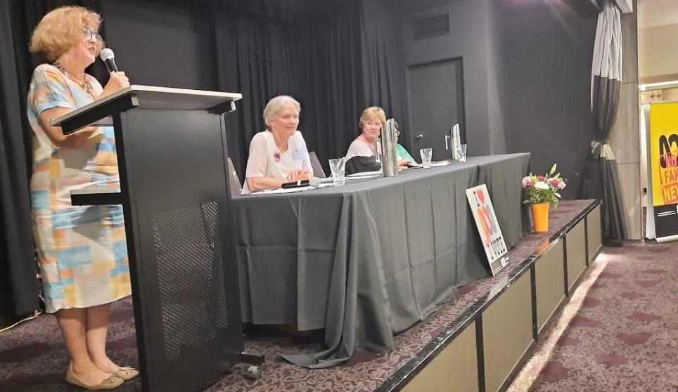 Interim Convenor Carmel McCallum speaking at podium