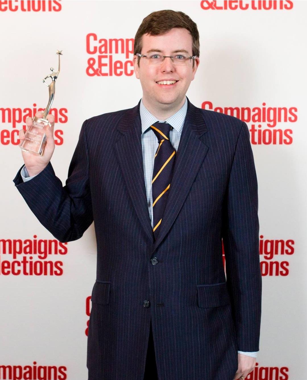 Hamish Marshall holding our Reed Award