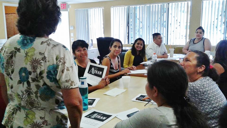 A-team members gather as one of the A-team members in San diego introduces herself to the team and speaks about her involvement with ACCE.