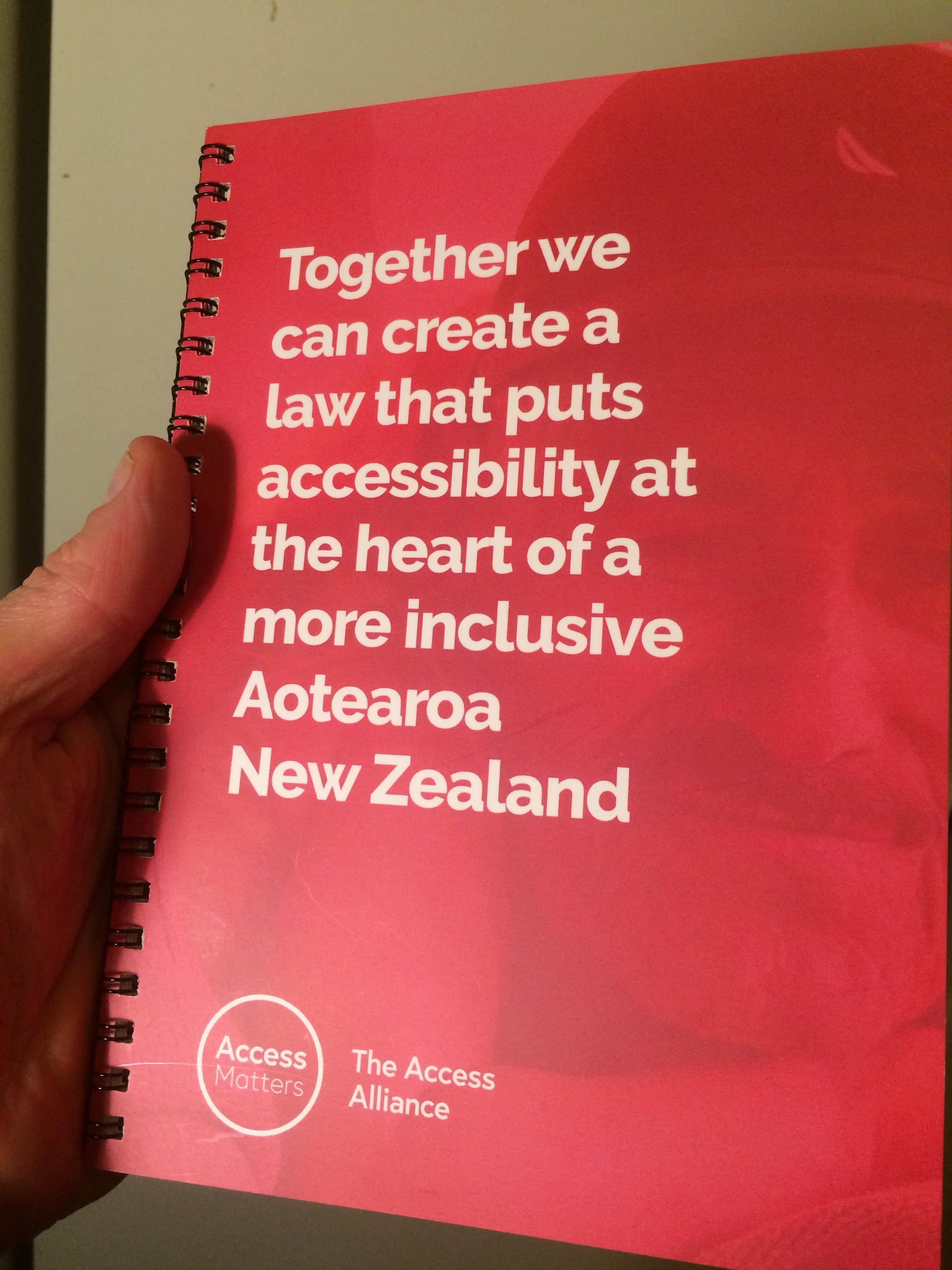 Cover of the Access Matters booklet is pink and has white text that says \