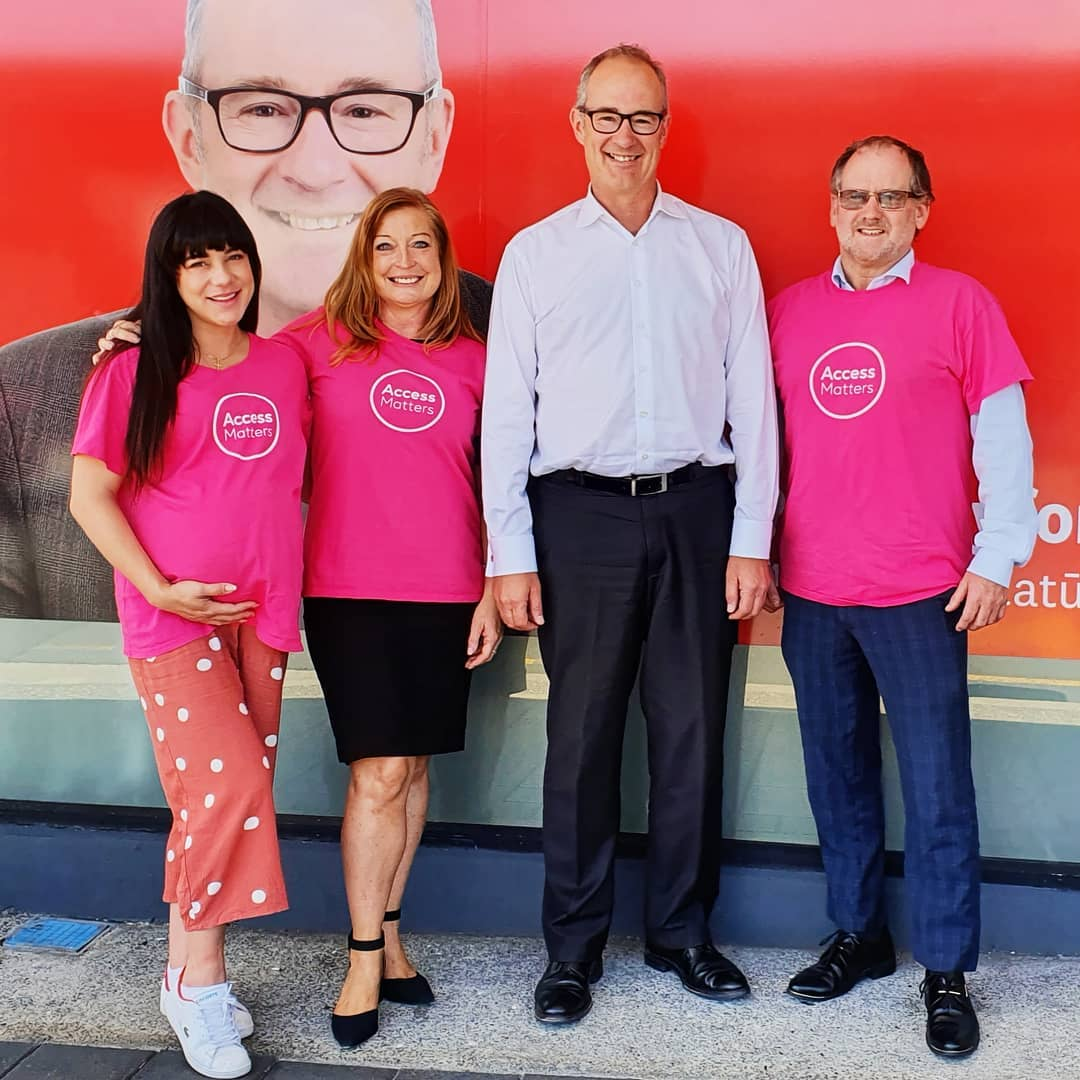 This colour photo was taken after a very successful meeting with accessibility advocate Mike Granger to discuss his access needs as a member of the Deaf community in NZ and Labour MP Phil Twyford with two other accessibility advocates Taryn Banks and Katy Thomas as supports for Mike