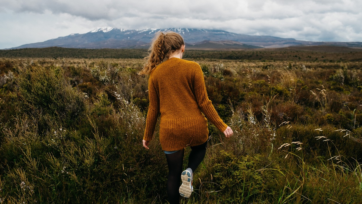 Woman walking in high country tussock
