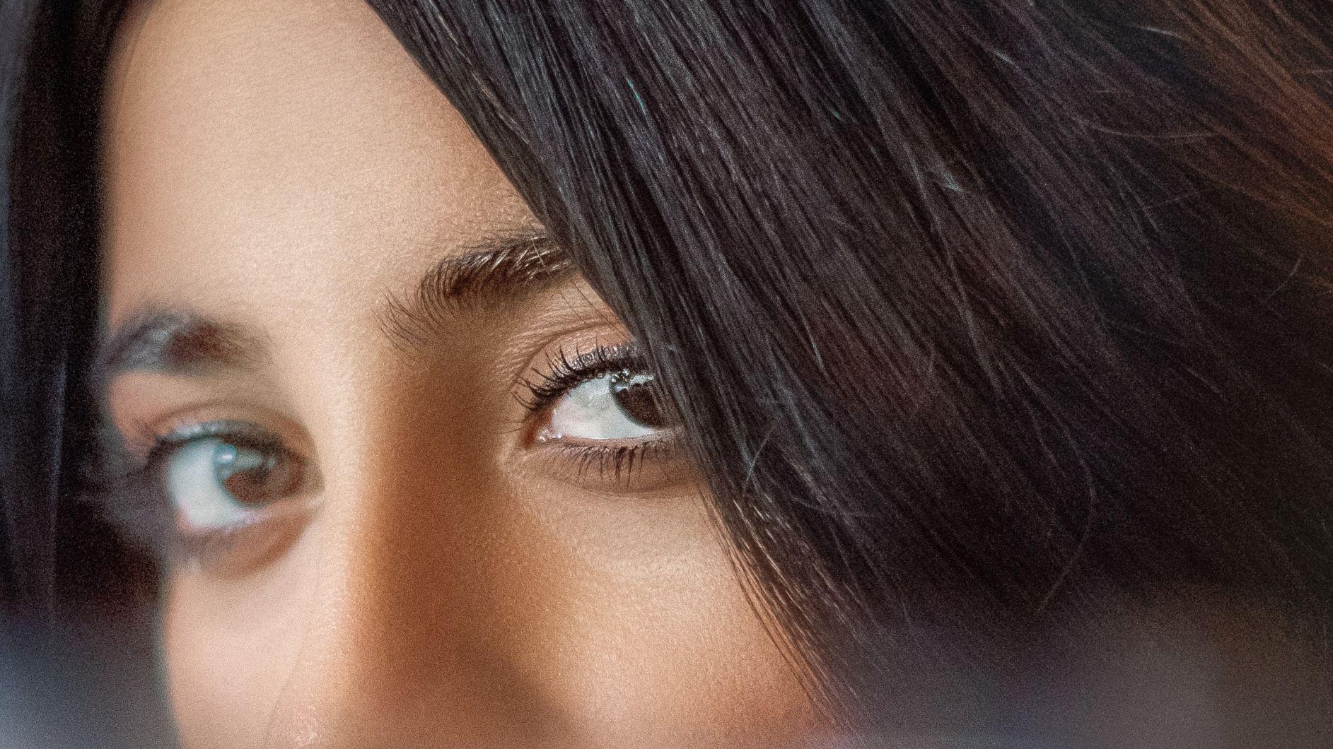 Woman looking through fringe