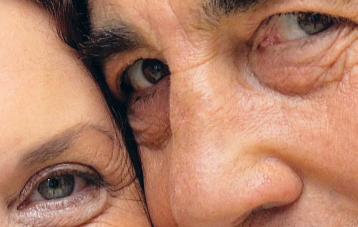 Man and woman faces close together