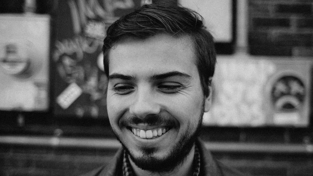 Young bearded man smiling