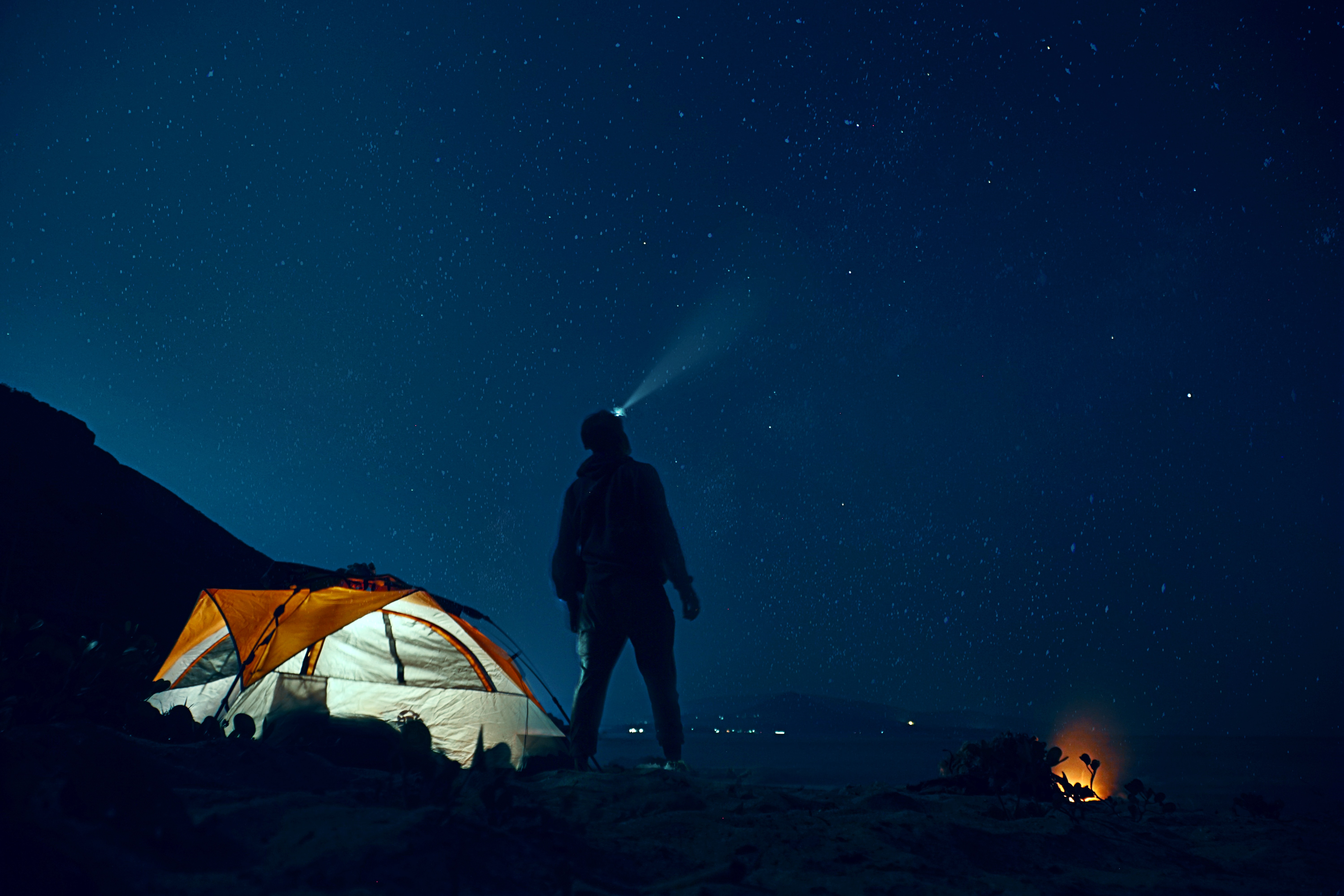 Camper looking up into starry night sky by Rahul Bhosale from unsplash.jpg