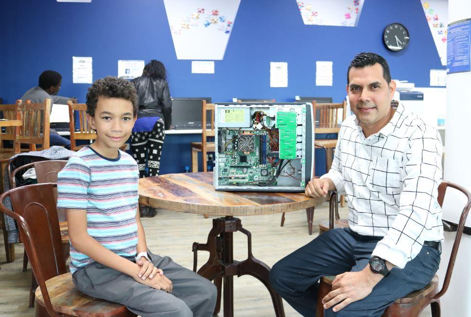 Kein Sheldrake and Alex Gasparillo with a computer