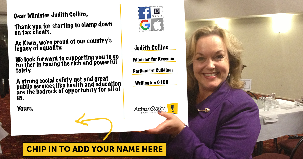 Judith Collins holding a giant card that says \