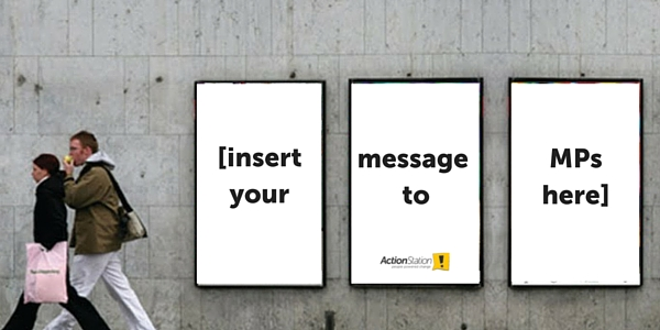 street posters that say: insert your message to MPs here